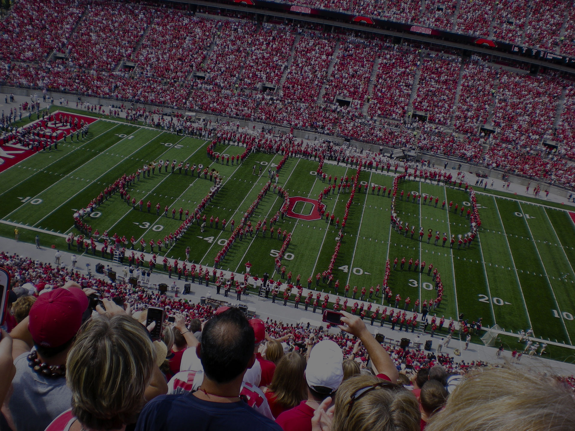 The Ohio State Alumni band performs the famous Script Ohio with the current OSU band before the game against Navy on September 5, 2009.